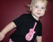 Pink Guitar on Black T-Shirt