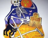 Vintage Halloween Die Cut Decoration with Skeleton in Graveyard with Cat and Jack O Lantern