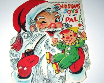 Vintage Unused Christmas Greeting Card with Jolly Santa Claus Smoking Pipe with Clown Doll and Silver Embossing