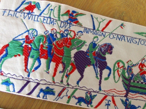 BAYEUX TAPESTRY Jacquard panel in green, red, purple, on ivory. 3 1/8 inch wide. 229-A