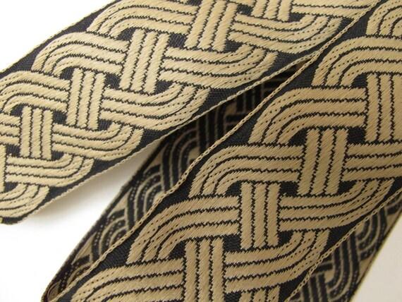 2 yards CELTIC RUNNING KNOTS Jacquard trim in tan jute on black. 1 1/2 inch wide. 834(2-2)-b