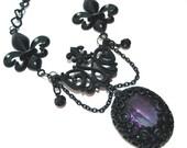 Gothic Victorian Necklace Black Filigree Purple Amethyst Glass Pendant with Fleur de lis accents - by NightsRequiem