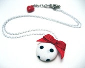 Polka Dot Necklace - Black and white polka dot circle pendant with red bow and thin white vintage chain - Rockabilly fabric necklace