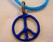 Reversible Blue Peace Pendant on Muli-Color Satin Cord