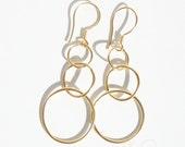 Gold vermeiled hoop earrings, about 2,3inch (6cm.) long