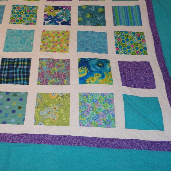 King size turquoise, green and purple quilt