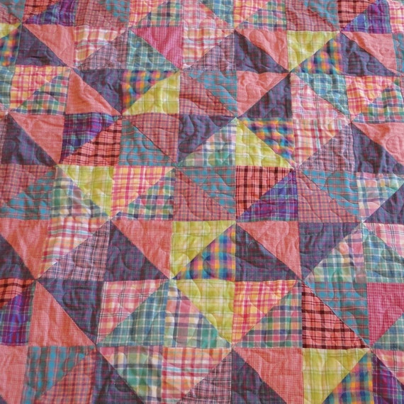 Brightly colored homespun twin size quilt