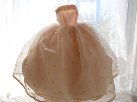 vintage 1950s doll prom formal. strapless with crinoline, peach with polka dot overlay.