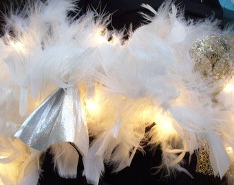 White feathers with gold and silver fabric on 9' of mini light garland