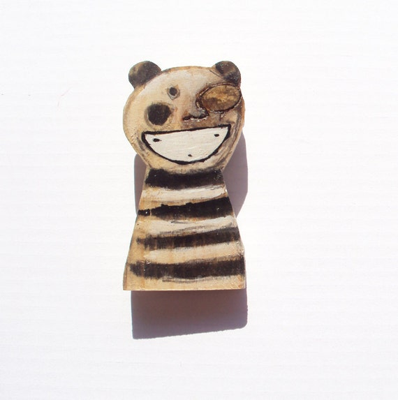 girl with stripes brooch