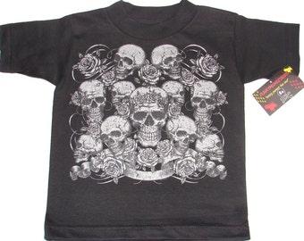 nwt black toddler tee or infant bodysuit of metalic skulls.