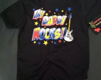 NWT black bodysuit or toddler tee of a guitar with wording my daddy  rocks