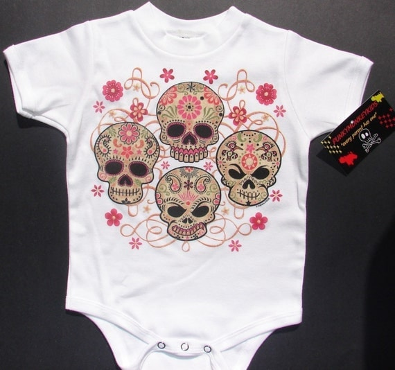 NWT white bodysuit, toddler or kids tee of 4 character skulls