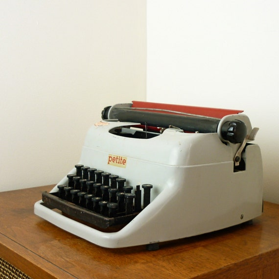 Gray and Red Metal Manual Typewriter