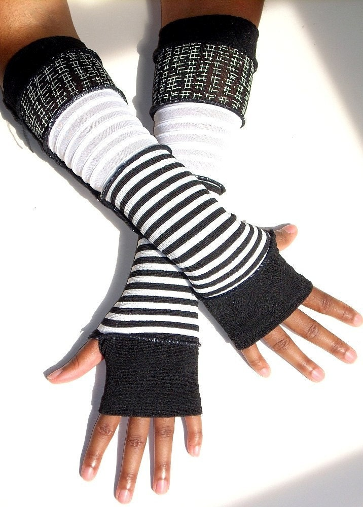 Our famous black and white fingerless gloves, now with words from the Bible, Romans chapter Each pair of Romans 12 cut off gloves is created from American-made, super soft .
