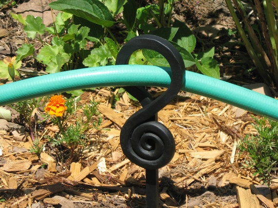 Items similar to 4 hand forged garden stakes hose guide by for Garden hose stakes