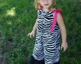 The Zebra Pillowcase Dress Gaucho Overalls with Hot Pink Ribbon Ties.  Sizes 6mo - 5T
