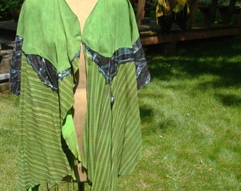 Peacock Green Lambsuede Vest ... Irridescent Zebra print on Black leather..Long, Full Lightweight.. Little sleeves by Rachelle Starr