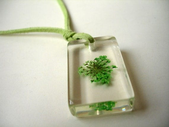 Another resin pendant with lime green flower and suede cord