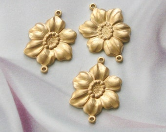 Raw brass larger sized stamped flower with 2 rings  Larger Size