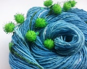 Handspun Art Yarn - ALIEN FROG POND - Light Blues and Aqua, with Green Glitter Pom Poms. Glows in the Dark. 196 yards, 3.10 oz