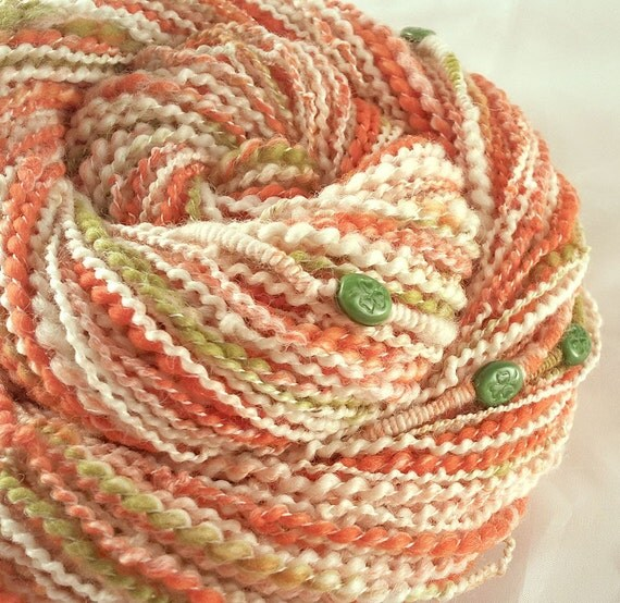 Irish Art Yarn - SHAMROCK CELEBRATIONS - Handspun Orange and White Art Yarn with Green Shamrock Beads. 129 yards, 3.32 oz. GLOWS in the Dark