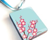 Pink cherry blossom on blue background wood pendant