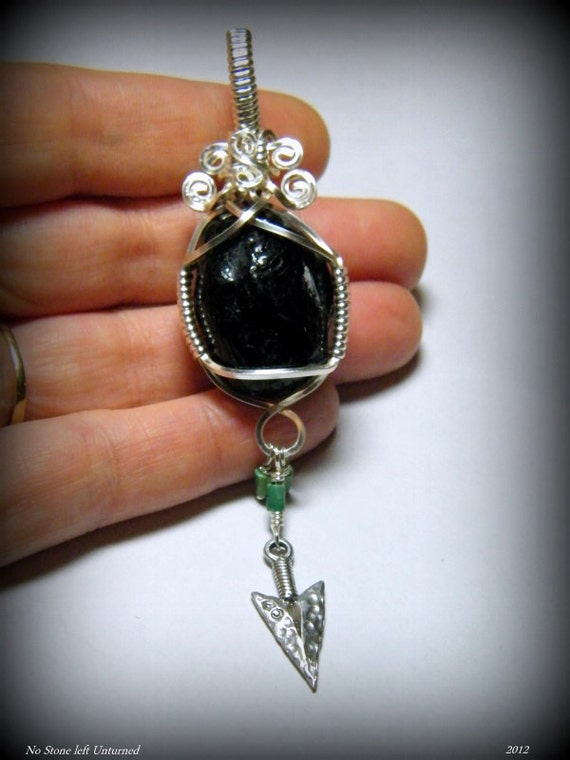 Apache's Tear: Authentic Apache's Tear with Turquoise and a pewter arrow head, pendant