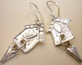 Bird house earrings.