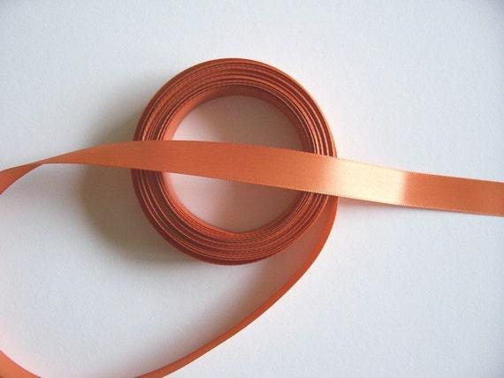 Double-sided burnt orange satin ribbon 5/8 inch wide x 5 yards