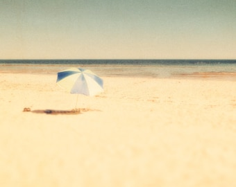 Beach umbrella nautical print sand beige summer trends seaside ocean waves pale blue horizon chilling Travel Photo