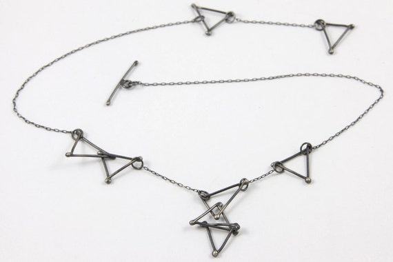 oxidized triangle necklace