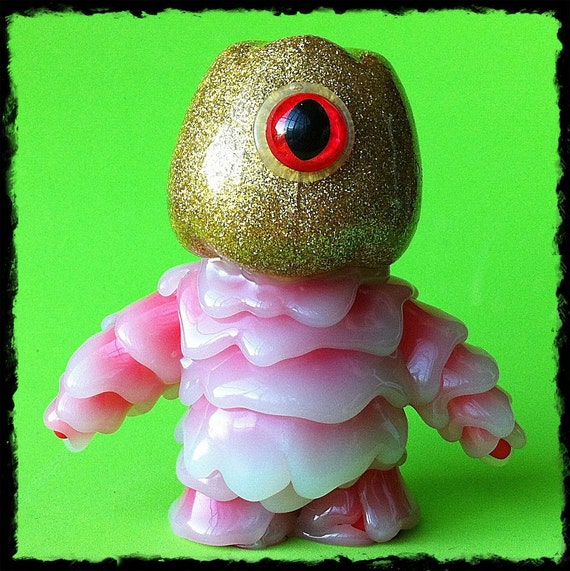 Fif...  Kaiju Melt Monster vinyl toy, with glow in the dark body...