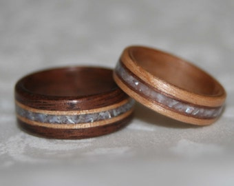 Set of Custom Wooden Wedding Bands with Wood Accents and Stone Inlay (Pictured materials are Black Walnut, Birch, and Pearl)