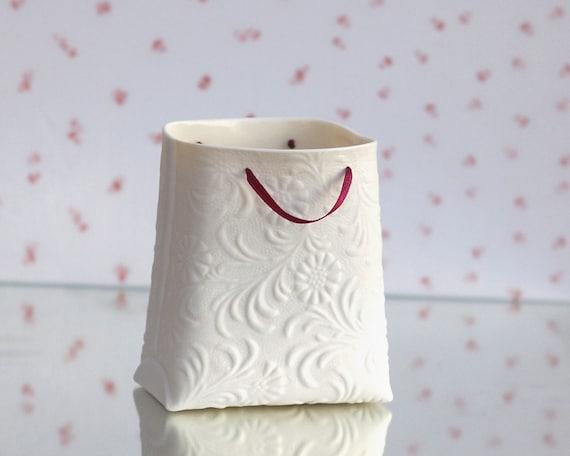 Porcelain textured bag (medium container). White ceramic cosmetics container. Designed by Wapa Studio.