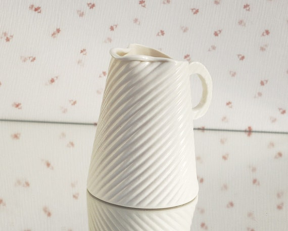 Porcelain creamer. I walk the line collection. Design by Wapa Studio.