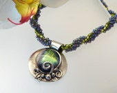 Purple Haze - Fine silver pendant with a glass cabochon and a handwoven bead rope