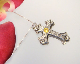Fine silver cross with a 4mm yellow sapphire corundum