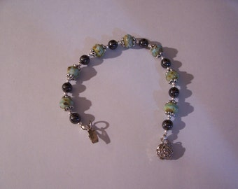 Turquoise Picasso Czech Glass Rondelles and black magnetic bracelet