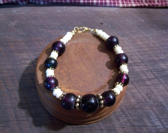 Bracelet made with Purple glass beads and Antique White Bone beads