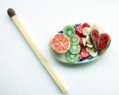 Miniature fruit on a china platter