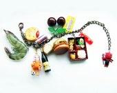 Charm bracelet, super kitsch, feeling peckish