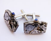 Large oblong shaped steampunk cufflinks with blue jeweled stems