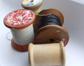 Four pretty vintage cotton reels