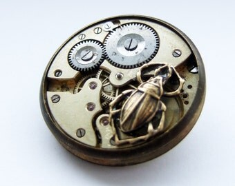 Steampunk scarab brooch, he weaves time into wasted seconds...