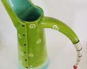 colorful lime pitcher w/ black and white stripe handle