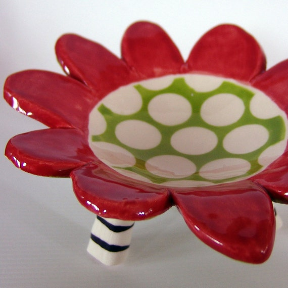 red polka dot soap dish with striped legs
