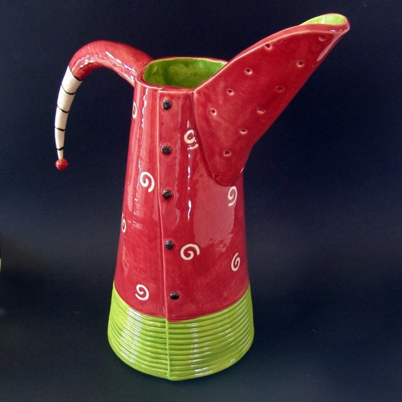 ceramic pitcher:) red, lime green w/ whimsical black & white stripe handle
