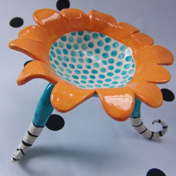 whimsical bright ceramic dish with legs