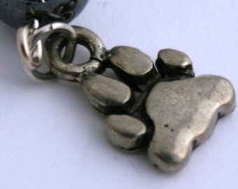 Small Silver tone bookmark with a silver tone bear claw dangle.